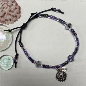 cocovalli Jewelry - NEW Purple sparkling bracelet slide knot charm